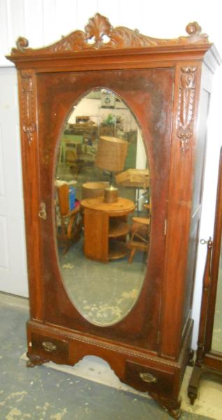 Armoire with mirror on door