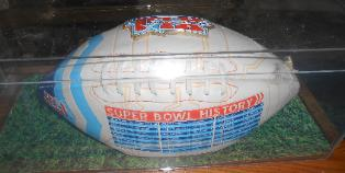 For auction Super Bowl XLI football in case