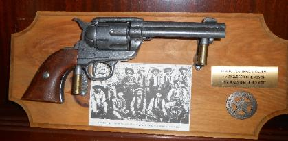 Reproduction Peacemaker pistol on wood plaque