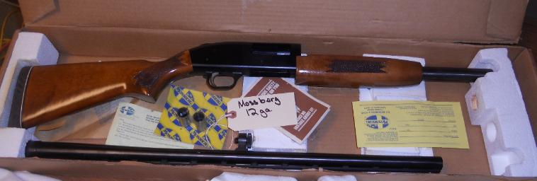 for auction Mossberg 12 gauge shot gun in box